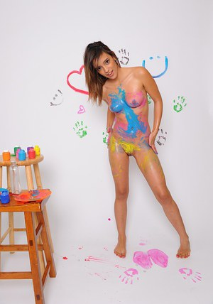 Nice teen babe Melanie Jane plays with paint and her sexy body