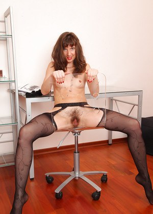 Mature hairy lady Victoria is posing in her brand new black stockings