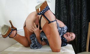 Clothed slut Marlyn enjoys revealing her fantastic body in her stockings