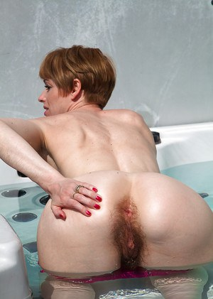 Super hairy pussy presented in the pool by amateur mature Maria