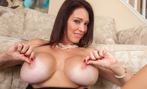Milf with big boobs Charlee Chase poses naked while husband is away