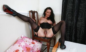Elegant and provocative mature brunette Marlyn with super hairy pussy