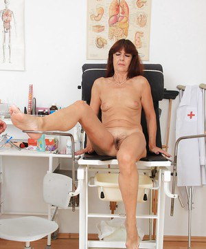 Mature with hairy pussy Lada pees in the ball and plays with toys