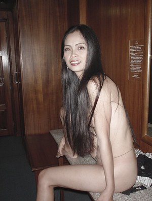 Long-haired Asian named Yuie undresses and masturbates on the table