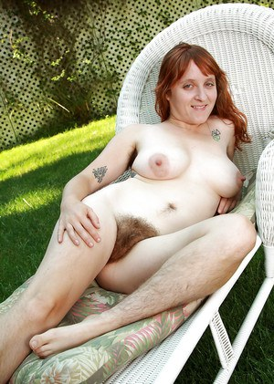 Mature redhead Velma with extremely hairy legs, pussy and armpits