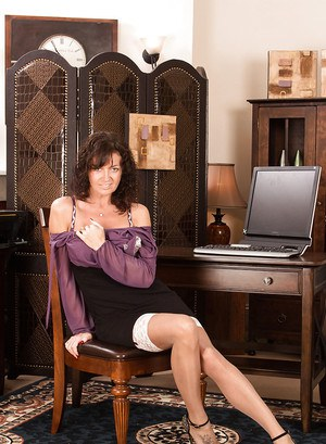 Brunette mature lady Lucy Heart is showing her fantastic stockings