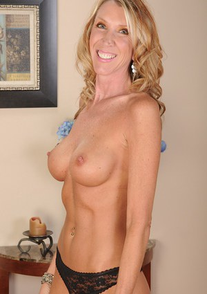 Skinny mature babe Brynn Hunter is teasing her shaved pussy
