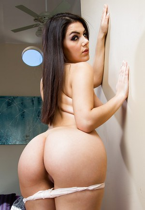 Dark haired European babe Valentina Nappi is showing her sexy legs