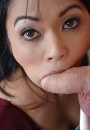 Cuddly Asian milf Mika Tan posing in high heels and banging at school