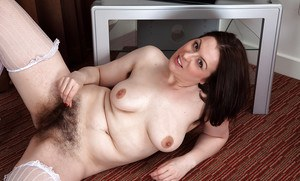 Lovely milf Jenna Brooke posing in stockings and fingering hairy snatch
