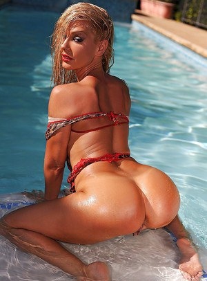 Glamorous and posh pornstar milf Sandy poses naked at the poolside