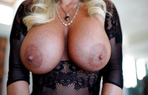 Big titted blonde housewife Sandra Otterson shows off her treasures