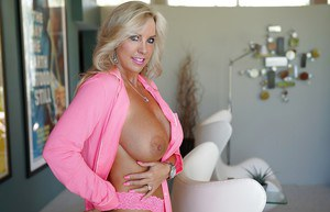 First-class housewife Sandra Otterson shows big tits and slender body