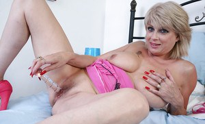 Very cute mature Dimonte masturbating and posing in high heels