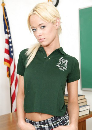 Clothed beauty Rebecca Blue is posing in her school uniform