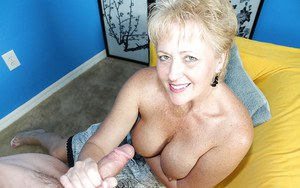 Dreamy mature with delicious boobies playing with sex toys