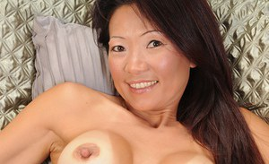 Natsuko Kurosawa undressing and getting fully pleased on the bed