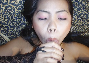 Adorable Yuyi demonstrates her skills in giving deep blowjobs