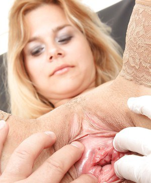 Stockings model Karen is demonstrating her milf pussy to her doctor