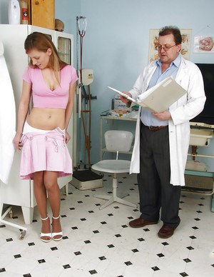 Olga Barz posing in stockings and having fun with her doctor