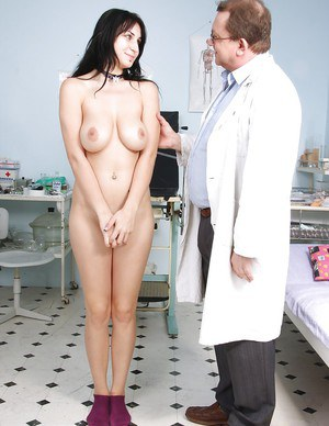 Brunette beauty Roxy Taggart is having her big tits teased by a doctor