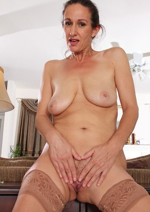 Genevieve Crest gets naked in her house and masturbates hard