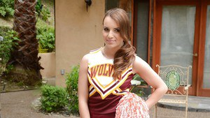 Beautiful babe Jenna Rose posing in a cheerleader outfit