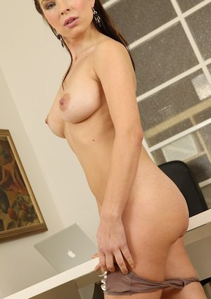 Gorgeous milf with an superb pussy Oxana Noy posing on camera