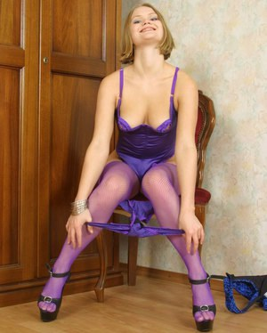 Marvelous girl with tiny boobies Irena is posing in violet stockings