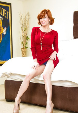 Mature babe Veronica Avluv is taking off her sexy red dress