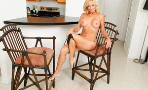Big boobed milf Dani Dare is demonstrating her perfect ass in the kitchen