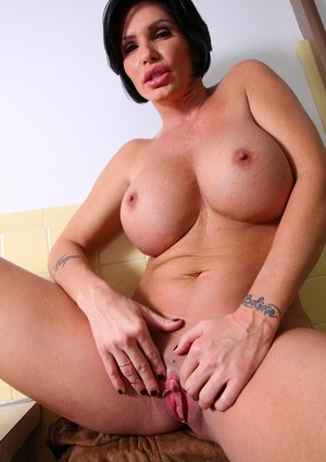 Superb mature babe with big tits Shay Foxx showing her boobies