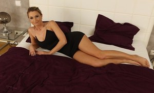 Charming milf Marillin Sweet playing with nipples in her bedroom