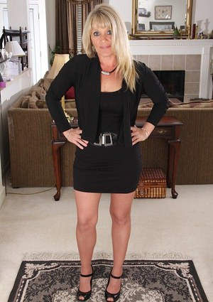 Clothed mature blondie Aubrey Adams is undressing in her office