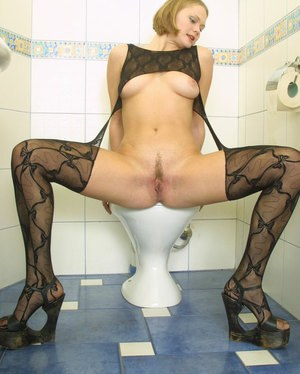 Beautiful lady with natural boobies Irena is showing off in the toilet