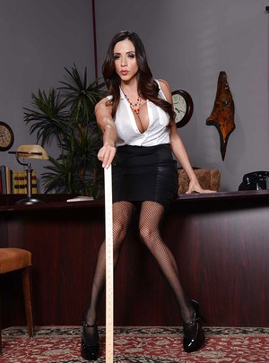 Latina babe Ariella Ferrera showing her titties in her office