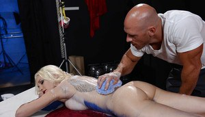 Blonde babe Stevie Shae receives an relaxing massage on a table