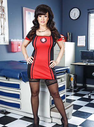 Clothed bitch Lisa Ann is posing in her sexy nurse outfit