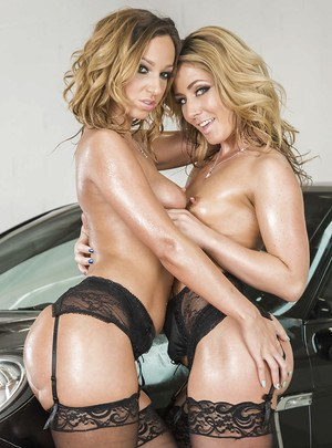 Lesbian chicks Jada Stevens and Sheena Shaw posing at a sweet car
