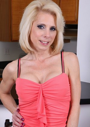 Tremendous mature babe Jodie Stacks is revealing her boobies