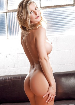 Blonde babe Kimber Cox is posing absolutely naked in her living room