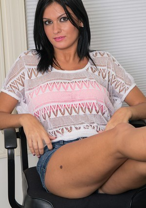 Skinny brunette Joanna Angel undressing in her office while working
