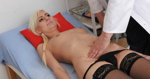 Gyno lover blonde Simone wears stockings that show her shaved pussy