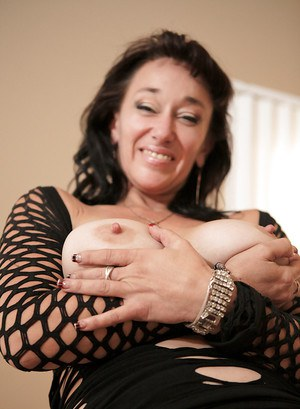 Mature brunette May shows her big tits and nipples spreading that pussy