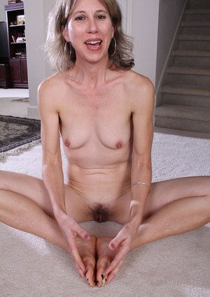 Mature Olive Jones spreading that hairy pussy with no panties on