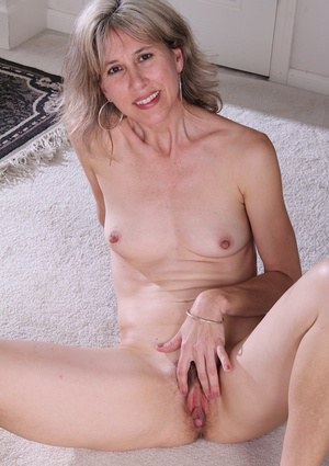 Mature babe Olive Jones shows her pantyhose that hiding that pussy