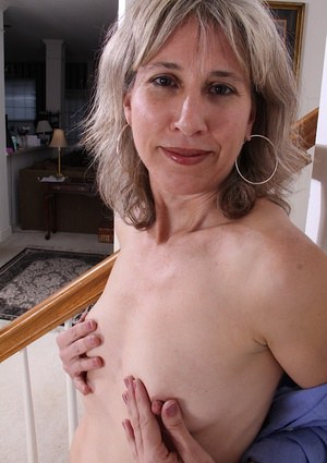 Tiny tits Olive undressing her body and spreading hairy pussy for us