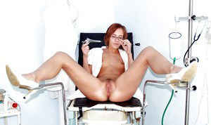 Fetish babe Jane masturbating her hairy pussy in gyno uniform