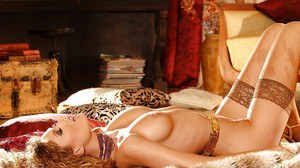 European girl in stockings spreading her legs and pussy in lingerie