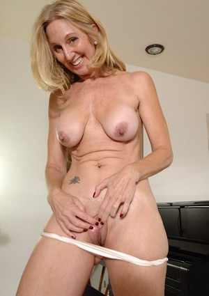 Blonde milf takes off her panties while playing with her big tits